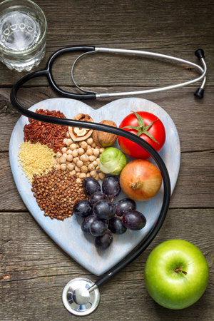 Healthy lifestyle concept with food on heart and stethoscope